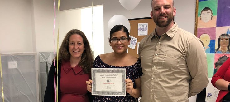 CHST Assistant Professor Maddy Fox and Director Jeremy Porter present Jennifer DeLaCruz the Gertrud Lenzer Founder's Outstanding Senior Award.