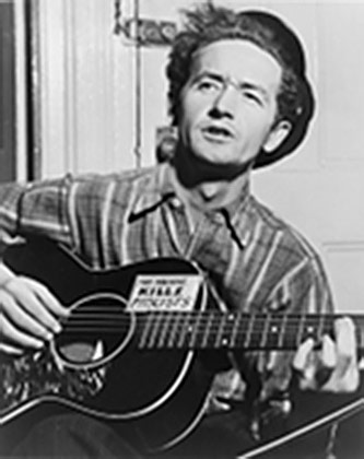 <p>Woody Guthrie, Photograph by Al Aumuller, courtesy of the Woody Guthrie Archives</p>