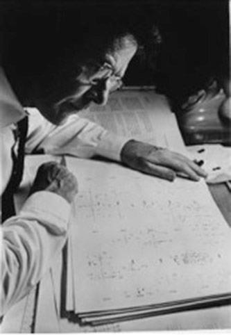 <p>John Cage, studying the score of <em>Atlas Eclipticalis</em> (1961) Photographer: Unknown Courtesy of the John Cage Trust</p>