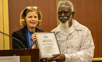<p>Pharoah Sanders receiving SAM's highest award from SAM President Kitty Preston. Photo by Michael Broyles.</p>