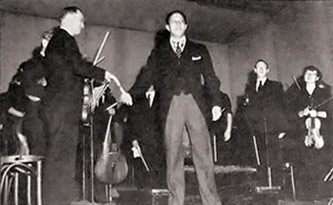 <p>Everett Lee conducting the Louisville Orchestra in 1953 as published in Jet, 1 October 1953</p>