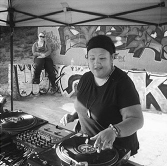 <p>DJ Kuttin Kandi making music. Courtesy of Kuttin Kandi</p>