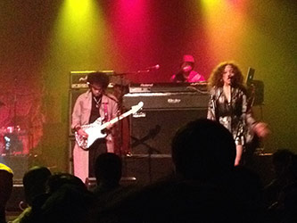 "<p>Left to right: Jesse Johnson (guitar), Cleo ""Pookie"" Sample (keyboards), and Kendra Foster (vocals) performing at the Best Buy Theatre, 11 March 2015. Photo by author.</p>"