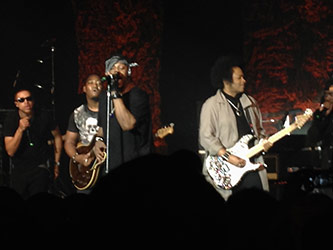 "<p>Left to right: Charlie ""Red"" Middleton (vocals), Isaiah Sharkey (guitar), D'Angelo, Jesse Johnson (guitar) performing at the Best Buy Theatre, 11 March 2015. Photo by author.</p>"