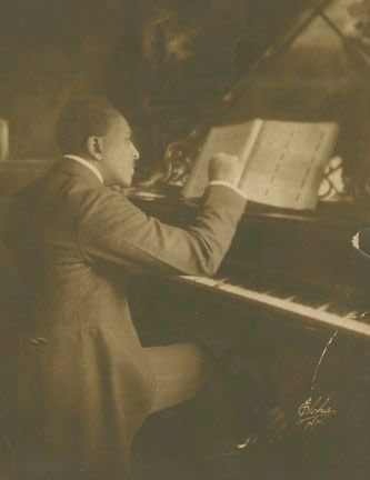 <p>H. Lawrence Freeman at the piano. RBML Archive c. 1921, Courtesy of Edward Elcha.</p>