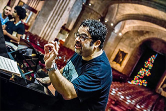 <p>Arturo O'Farrill during soundcheck/rehearsal at the Basilica of St Francis of Assisi, Havana, Cuba, 10 December 2016. Photo by David Garton</p>