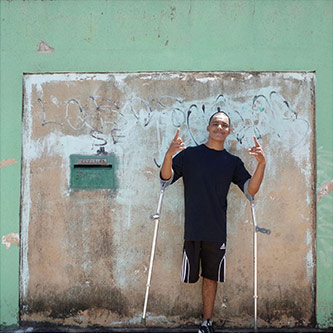 <p>Samuel Henrique da Silviera Lima (aka B-boy Samuka) stands outside his home in Ceil&acirc;ndia, Brazil, near the capital Brasilia. 15 March 2017. Samuel participated in Next Level's Brazil residency. Photo by the author.</p>