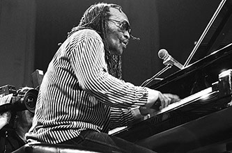 Cecil Taylor performing in 1987, Photo by Frans Schellekens