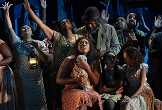 Residents of Catfish Row shelter from the hurricane from Met's production of <em>Porgy and Bess</em> (2019)