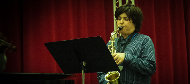 A teenage saxophonist expresses his love for music.