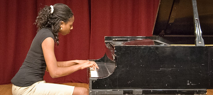 A graduating piano student performs one last time before she leaves for college.