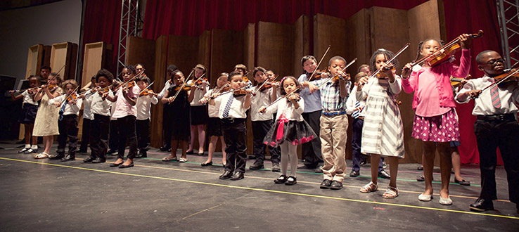 Our Suzuki program violin students at one of their special performance events.