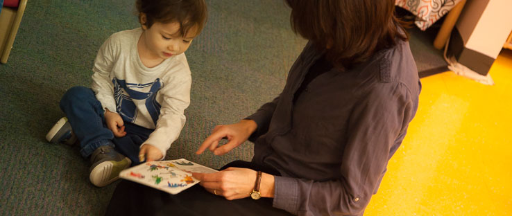 Children and teachers engage in curiosity and wonderment as they share in the magic of stories and pictures.
