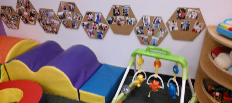 1<p>The children in the Infants Room can climb, crawl, tumble, and play while they look at and touch their family photos.</p>
