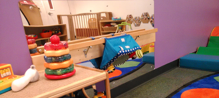 1<p>The mirror in the Infants Room invites and encourages the children to engage in playful games of peek-a-boo while they form attachments to and bond with their teachers.</p>