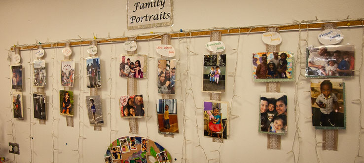 In the Twos Room family portraits hang for the child to touch, hold and carry with them throughout the day.