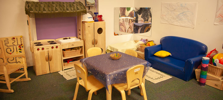 The Twos Classroom holds an inviting play space for imaginative play and wonderment.
