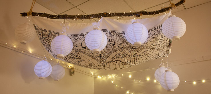 Lights and lanterns hang in the Twos Room inviting conversations around play and wonderment.