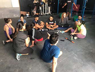 <p>Participating with a fitness class as part of Professor Hejtmanek's research</p>