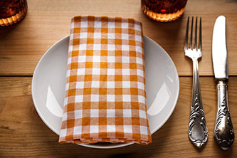 Table setting with plate, fork, knife, and napkin