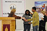 <p>Professor Louise Hainline presents Miriah Golphin and Dillon Heera, students at Teachers Preparatory, who won in the high school division for their research on sustainable agricultural methods in their Brownsville neighborhood.</p>