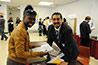 <p>RISE coordinator Alejandro Huezo with Camillia Monestime preparing to judge posters.</p>