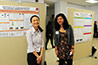 <p>Caroline Chung and Emily Paolillo have a chat as they wait for their posters to be judged.</p>