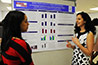 <p>Rita El-Haddad talks to a student about her research on adults with dyslexia.</p>