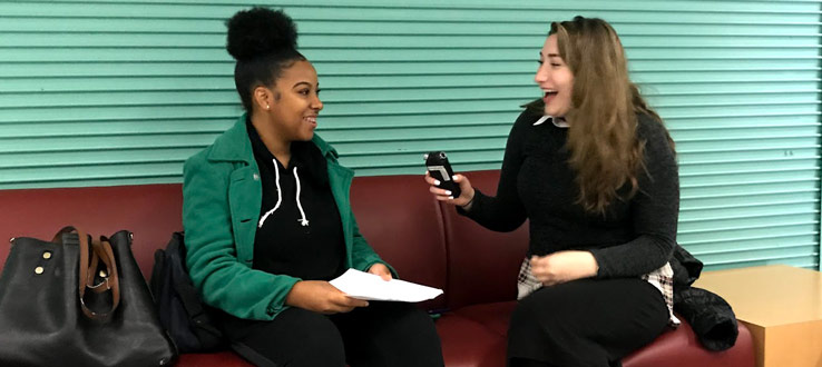 Two students practice interviewing before they go out to do their oral histories for the Brooklyn College Listening Project.
