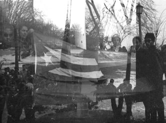 Black and Puerto Rican students took turns flying the Puerto Rican and Black Liberation flag from the BC flagpole.  Circa 1969. (Photo credit Antonio Nieves '72)