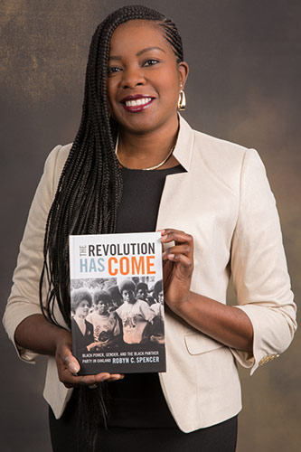 <p>Dr. Robyn C. Spencer with her book <em>The Revolution Has Come: Black Power, Gender and the Black Panther Party in Oakland</em></p>