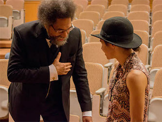 <p>Dr. Cornel West speaking to a Brooklyn College student.</p>