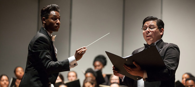 1<p>Conductor Malcolm J. Merriweather directs baritone soloist Jeffrey Perez with the Symphonic Choir and Conservatory Singers in their performance of Carl Orff's <em>Carmina Burana</em>.</p>