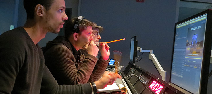 1<p>Professors and students observe the live production from Master Control.</p>
