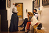 <p>Three of the actors in costume backstage waiting for the play to begin.</p>