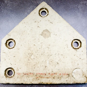 Showing signs of wear, this home plate from Ebbets Field bears the curse shared by many Brooklyn Dodgers fans: