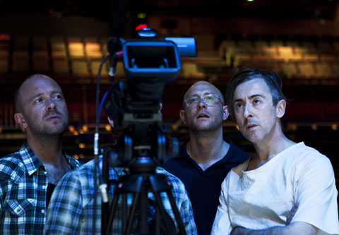 Co-directors John Tiffany (left) and Andy Goldberg (center) and actor Alan Cumming check the closed-circuit videos used in their production of Macbeth.