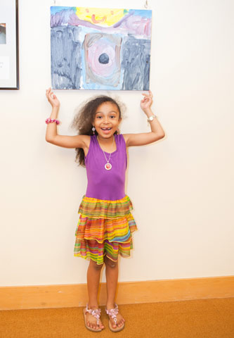 Safira LaRosa poses in front of her work.