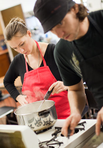 Students work in teams as they create meals in the on-campus kitchen.