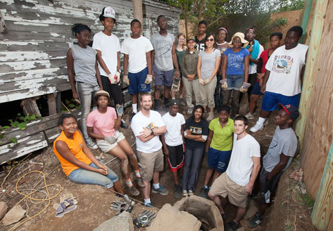 Students gather around the cistern at the historic Lott House.