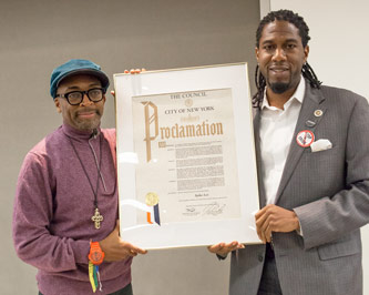 Famed filmmaker Spike Lee receives a New York City proclamation from Councilman Jumaane Williams '95.