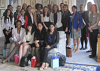 Irene Waxman '70 (second row, center), executive director of human resources at Estée Lauder, gathers with Brooklyn College students at company headquarters. Human Resources Associate Amy Linda stands second row, third from left, and Suzanne Grossman, career education and training coordinator at the Magner Career Center, stands second row, far right.