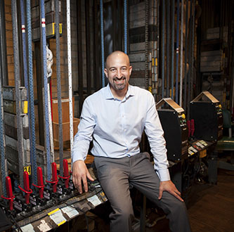BCBC's new director, Jon Yanofsky, backstage at the college's Whitman Theater.