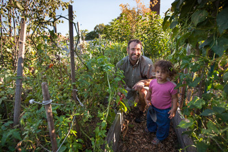 Gardener Murray Lantner and his one-year-old daughter, Meitar, enjoy shoveling, planting, and reaping the garden's rewards.