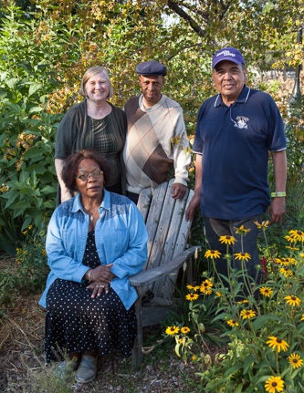 Greenthumbs in the green space: Rosita Azuma (seated), Professor Louise Hainline, Officer Tafari Sherry, and Pablo Garcia.