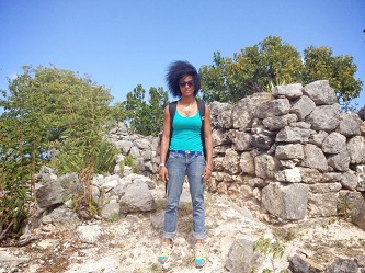 <p>Jen-I Costosa '13 prepares to work at one of the sites of study in Barbuda.</p>