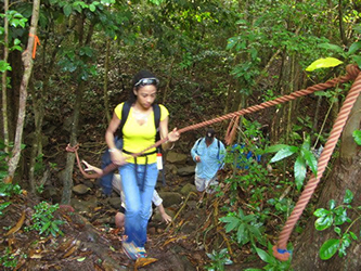 <p>Jen-I Costosa '13 utilizes mountain climbing equipment during a hike to an archaeological dig in Barbuda.</p>