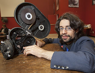 <p>Morgann Gicquel handling a traditional 16 mm film camera.</p>