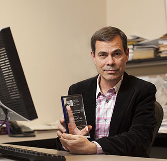 <p>Carlos A. Cruz, the multimedia, instructional deisgn specialist and Blackboard/Sakai administrator at the Brooklyn College Library, showing his award. </p>