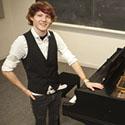 Eisenhauer standing next to a grand piano